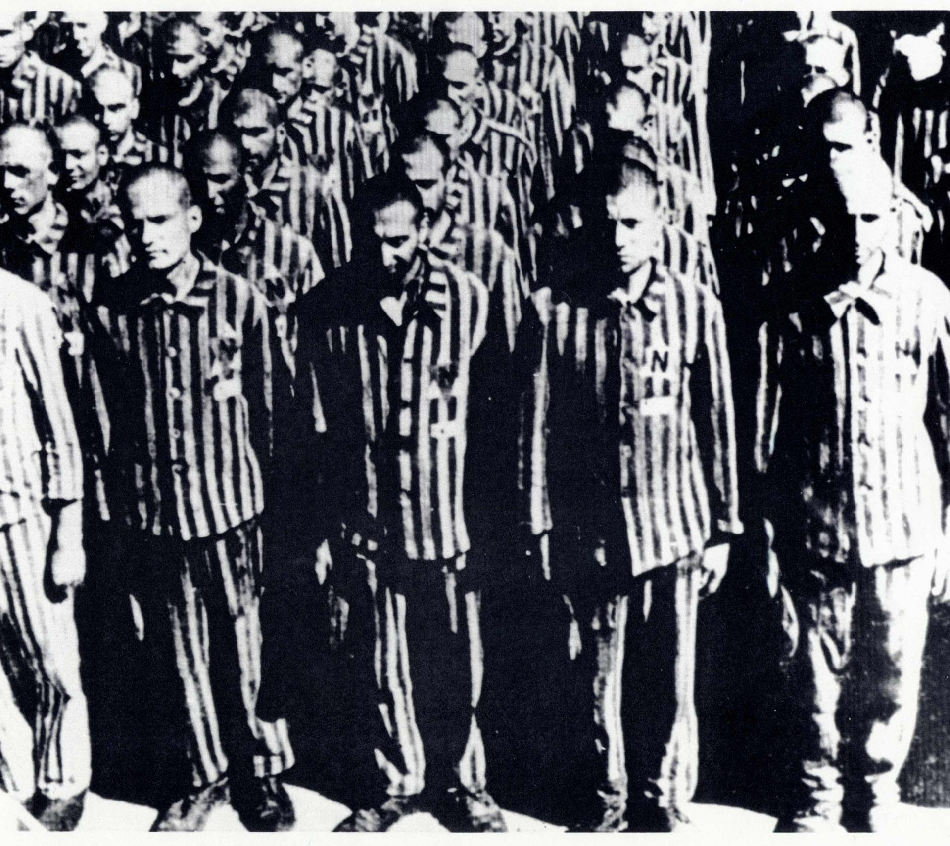 Dutch prisoners at the Buchenwald concentration camp, February 28, 1941. This photo illustrates both the dehumanization of the prisoners and a mountain of corpses: they all have their heads shaved, all wear the same uniform and they stay in a row for hours.