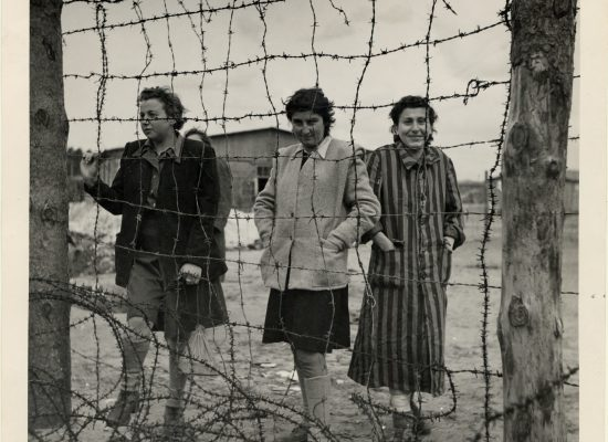 Three women at the Bergen-Belsen concentration camp after liberation. Germany, 1945.