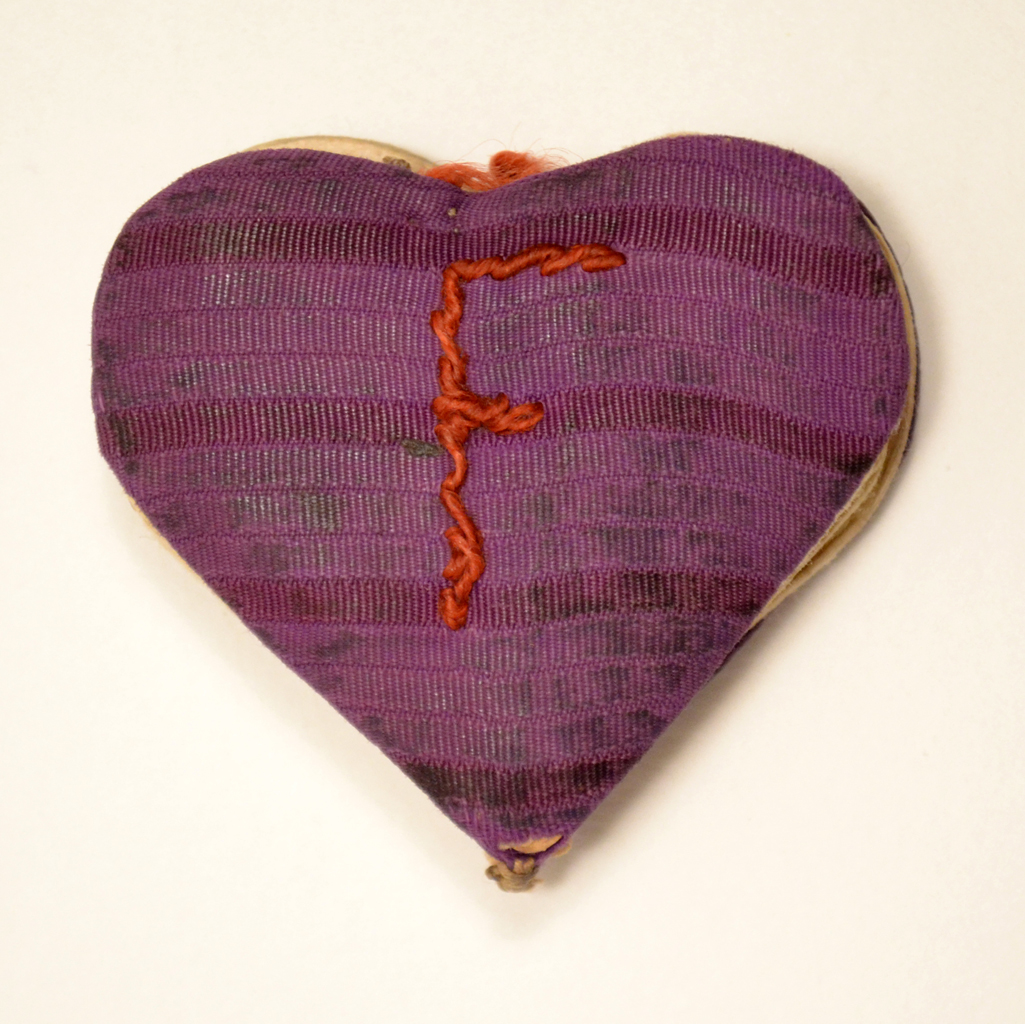 The heart-shaped booklet is a birthday card offered to Fania Fainer for her 20th birthday on December 12, 1944, while she was in Auschwitz.