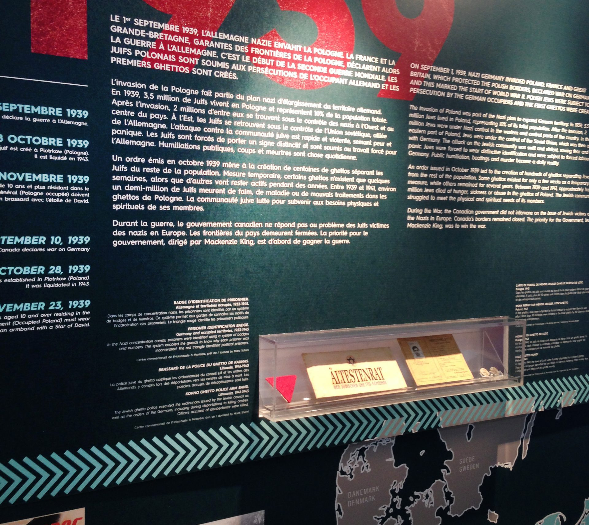 "A look at the first of two artefact display cases in the travelling exhibition, ""And in 1948, I came to Canada"": The Holocaust in Six Dates."""