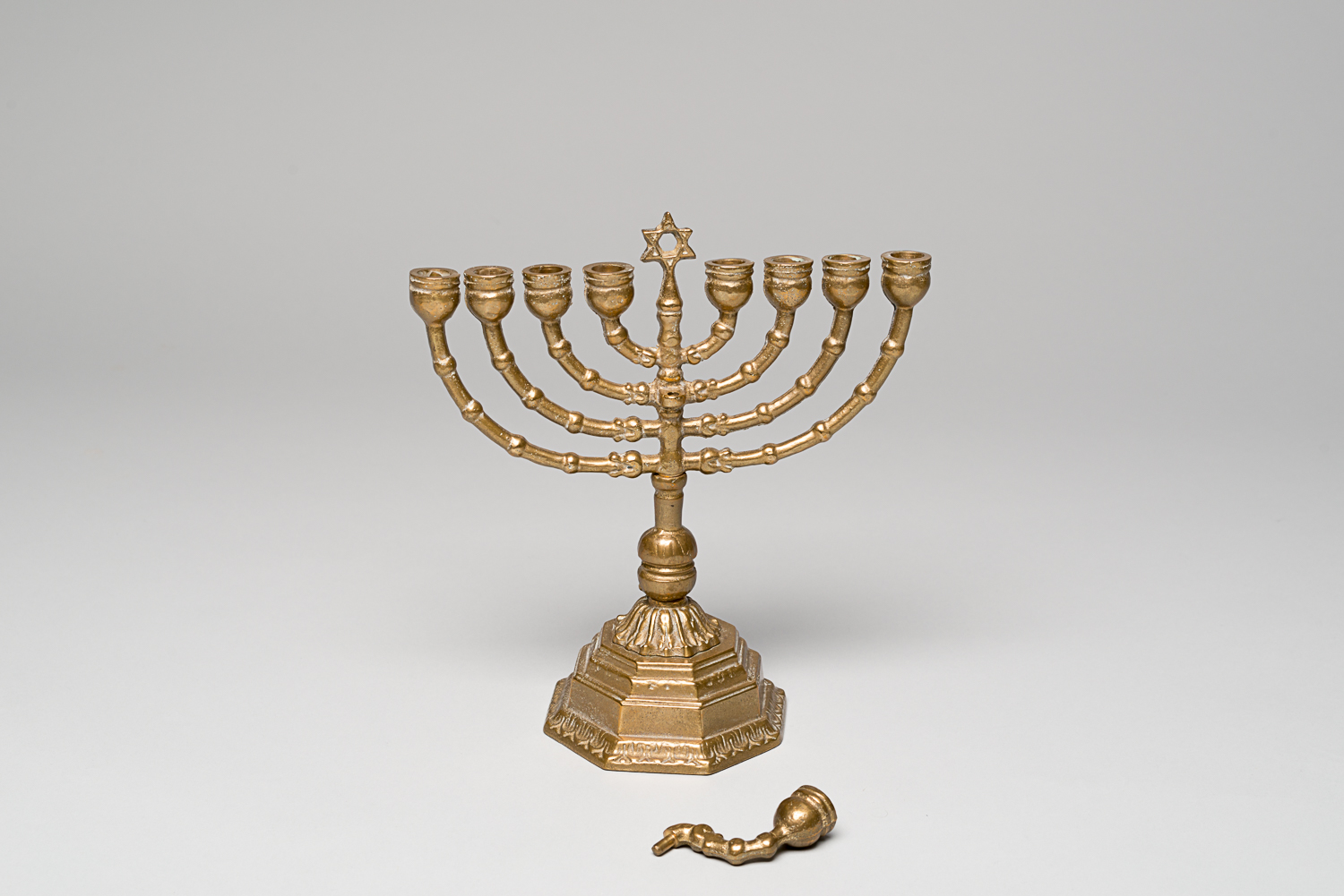This Hanukkah lamp (or Hanukiah) is a significant object in Jewish tradition. Its eight candles commemorate the miracle of the Second Holy Temple in Jerusalem. (Photo: Peter Berra)