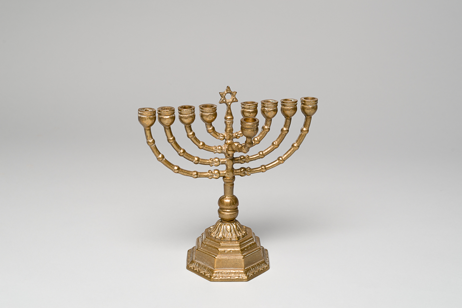 The shamash, the ninth holder of the Hanukkah lamp, is used to light to other eight candles. (Photo: Peter Berra)