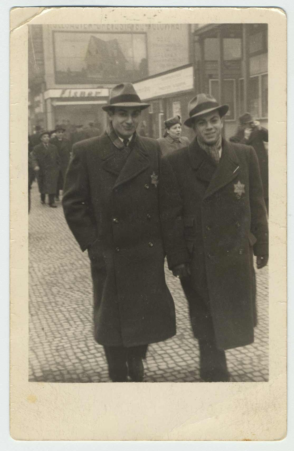 George and Karel Ehrman, photographed on Prikopy street in Prague in 1941. They both wear a yellow star on their coats.