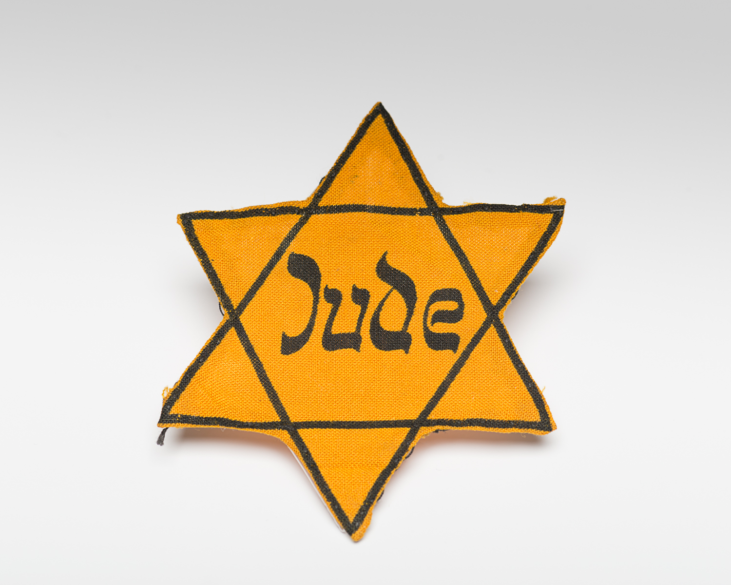 This badge was worn by George Ehrman while he was living in Prague. (Photo: Peter Berra)