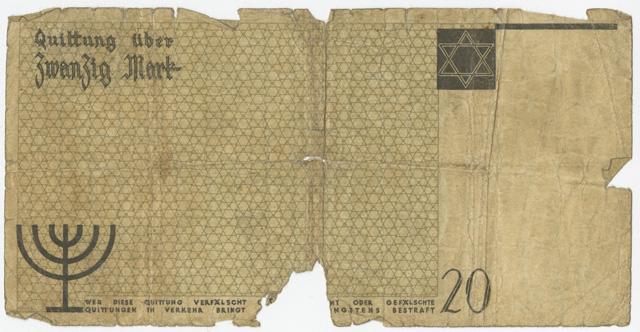Ce papier-monnaie de 20 marks du ghetto de Litzmannstadt (Lodz) présente des symboles juifs facilement reconnaissables : L'étoile de David et une menorah sur le verso.
