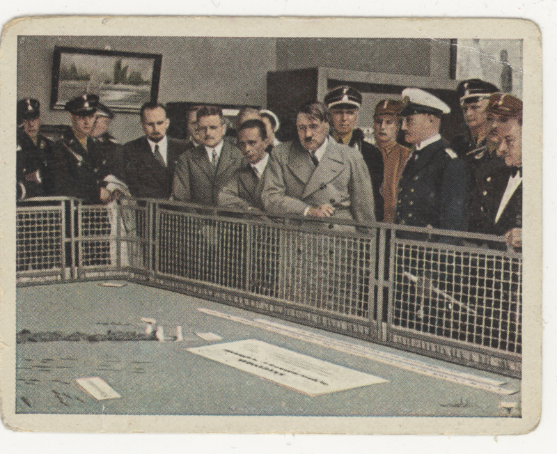 Cigarette cardstock showing Hitler at the Industrial exhibition in 1933. The VE301 radio was shown to the public at this event.