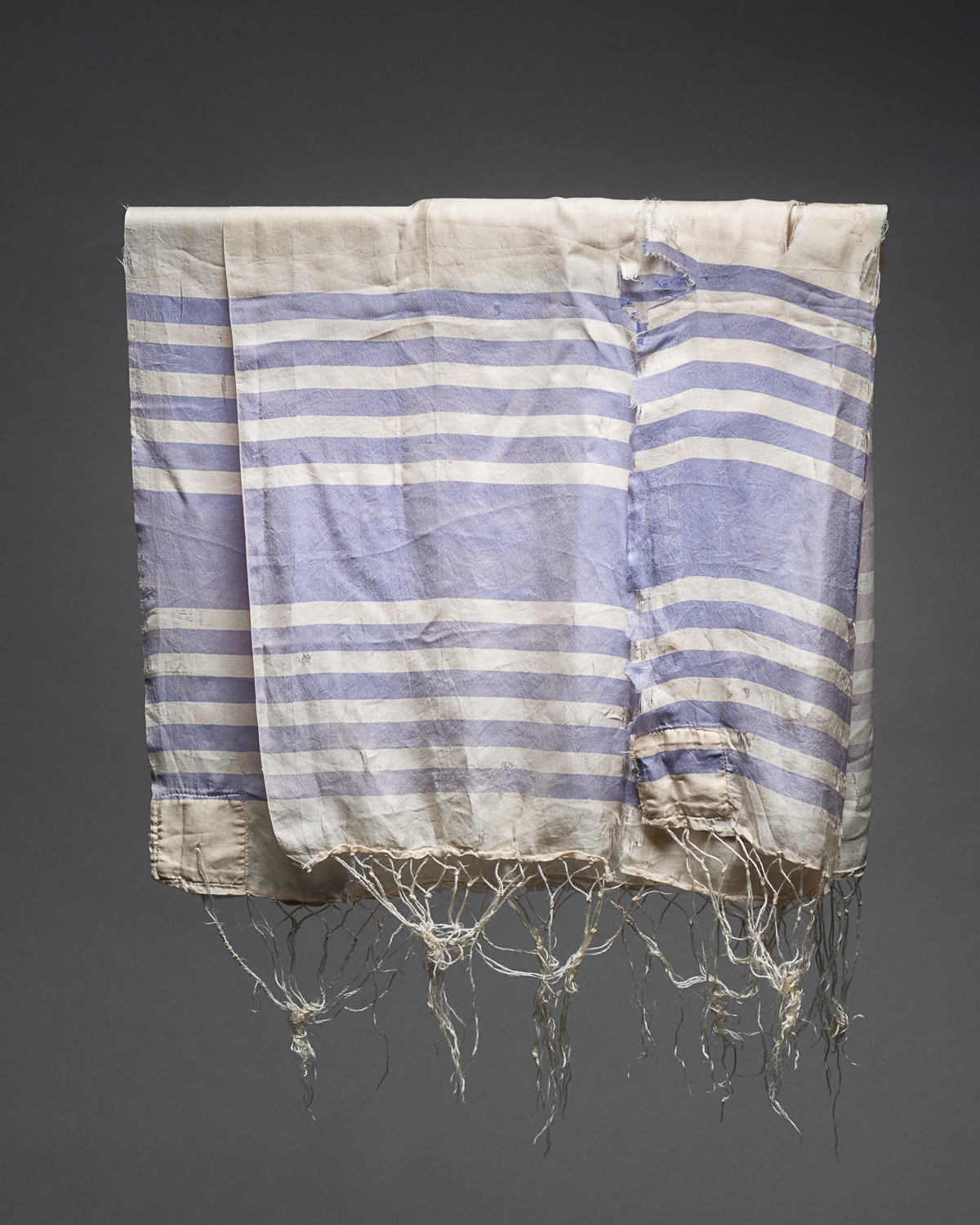 A prayer shawl, or tallit, is worn by Jewish men during prayer recitations. This shawl belonged to Harry Cohen who lived in Montreal before the war. (Photo: Peter Berra)