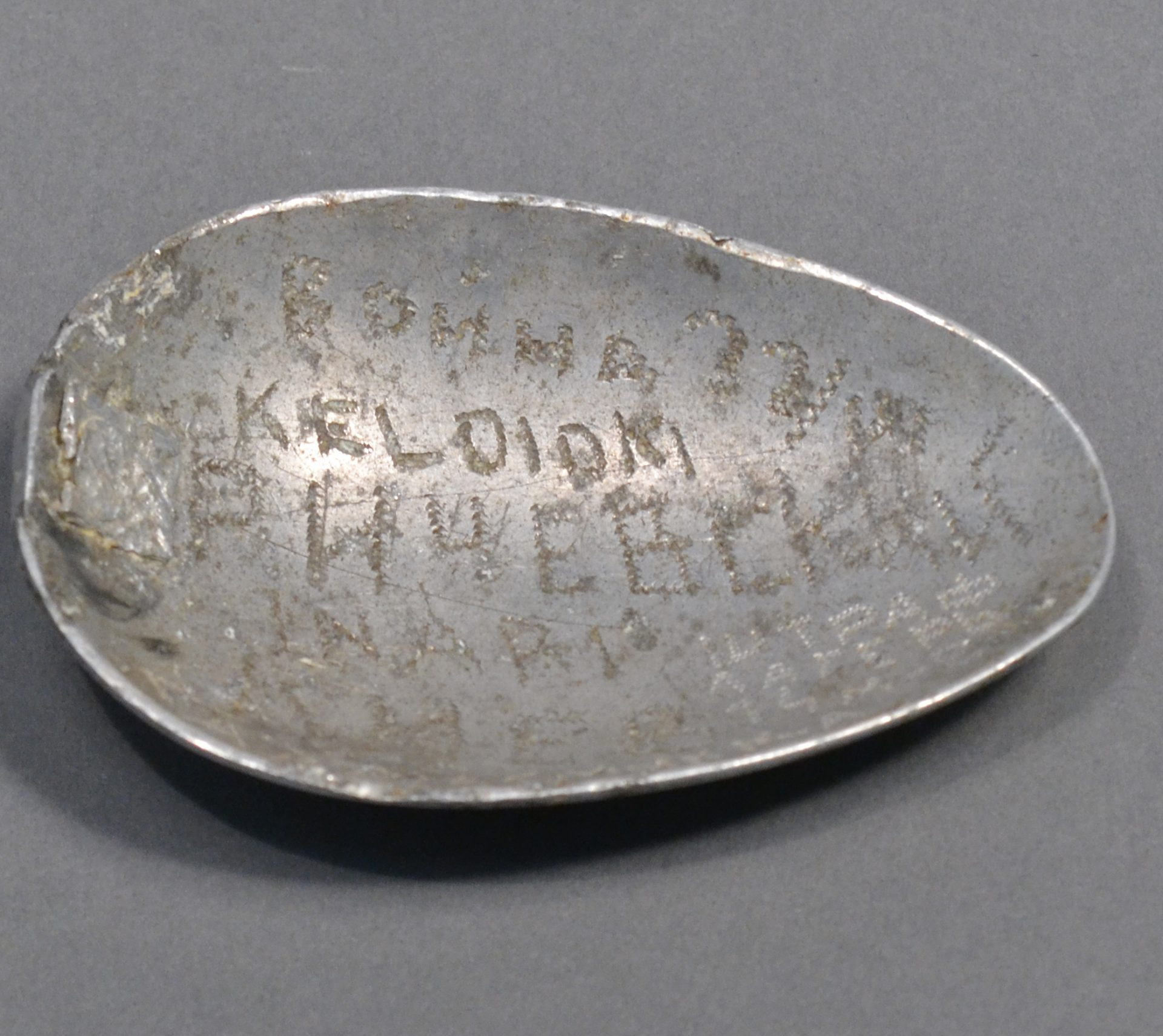 Ilya Krishevsky engraved inscriptions on this spoon, which is missing a handle.