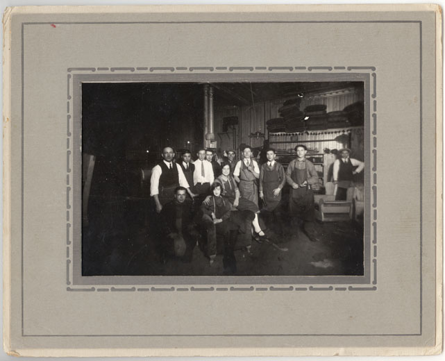 Adolph Singer is pictured on the left of this photograph of workers of the Ideal Upholstering factory, circa 1920.