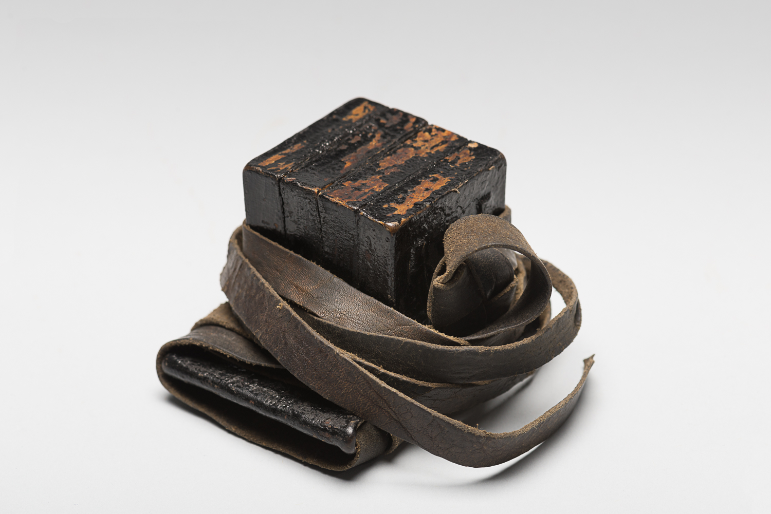 The straps are wrapped in a specific way during prayer recitations. (Photo: Peter Berra)