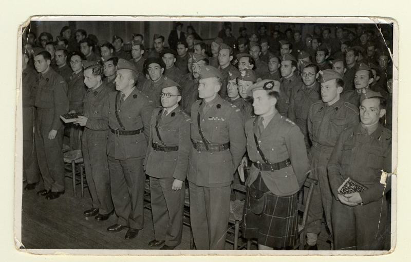Polish soldiers in Scotland during Rosh Hashanah, the Jewish New Year celebration. Willie Glaser is standing in the third row wearing glasses.