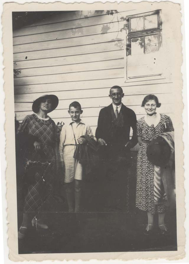 In this photograph, Willy Deutz wears a dark suit and is accompanied by two women and one young man. During the Summer of 1935, the Deutz family was in Wilhelmsbad, Germany.