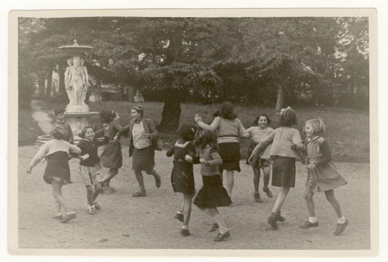 Young girls from the Andrésy orphanage dancing in the park. Celinka is the first girl on the right.