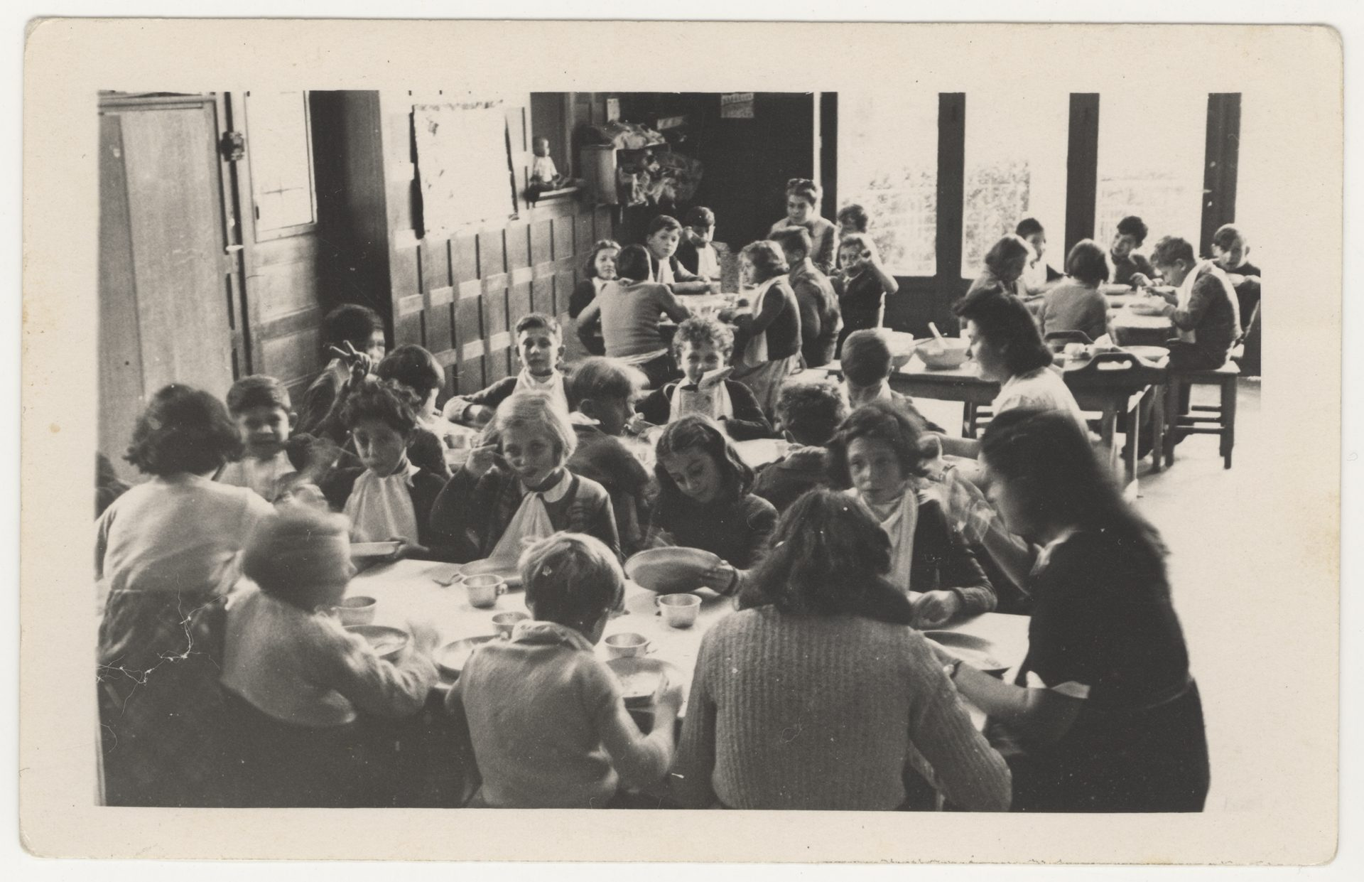 Photograph was taken in 1945 at the OSE (''Oeuvre de secours aux enfants'') orphanage in Andrésy, a town located north-west of Paris, France. Celinka Zilberbogen sits at the first table and looks at the camera while eating.