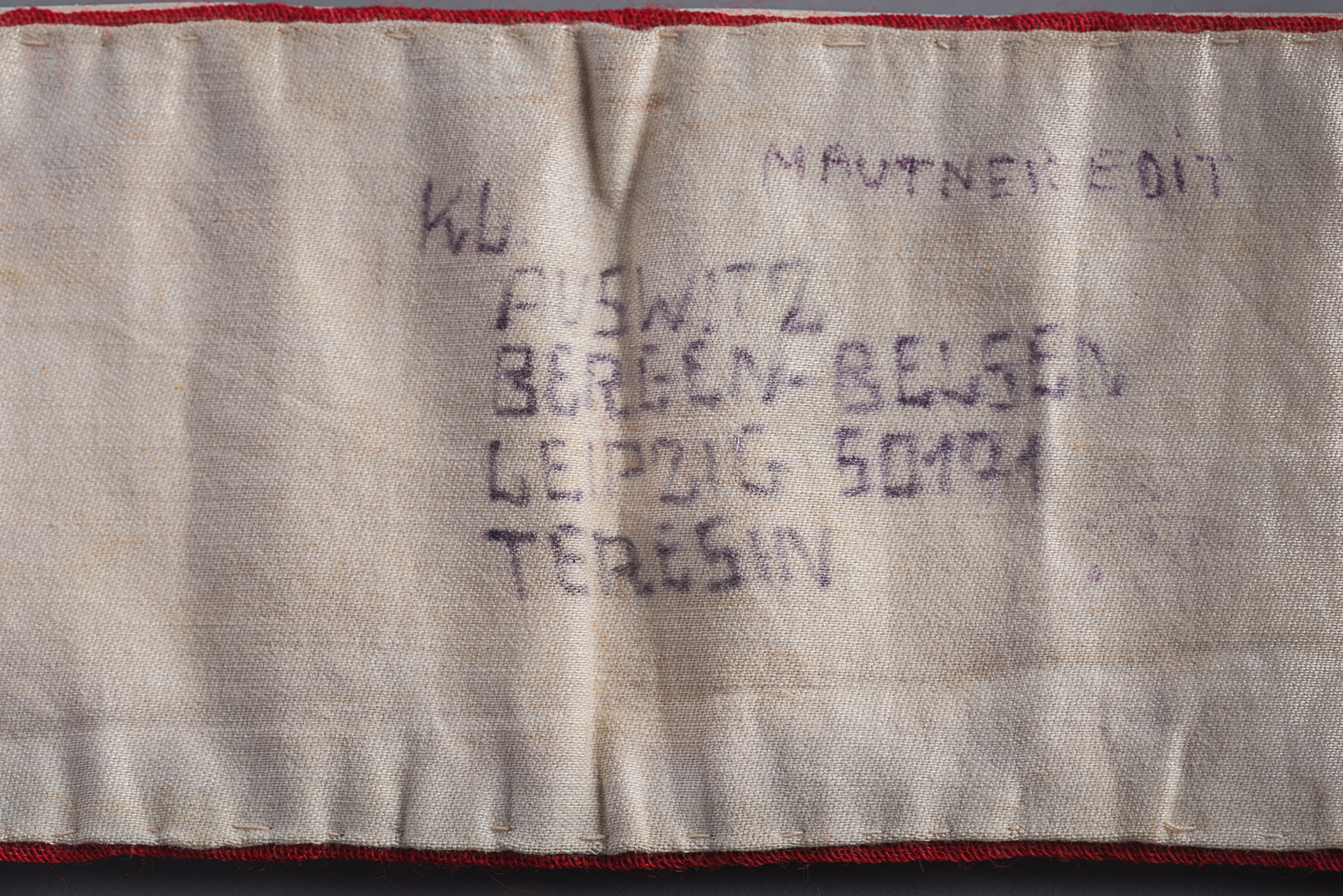 Her prisoner number 50171 is also written on the armband. Edith wrote these inscriptions after the war as a memento of her experience in Nazi concentration camps.