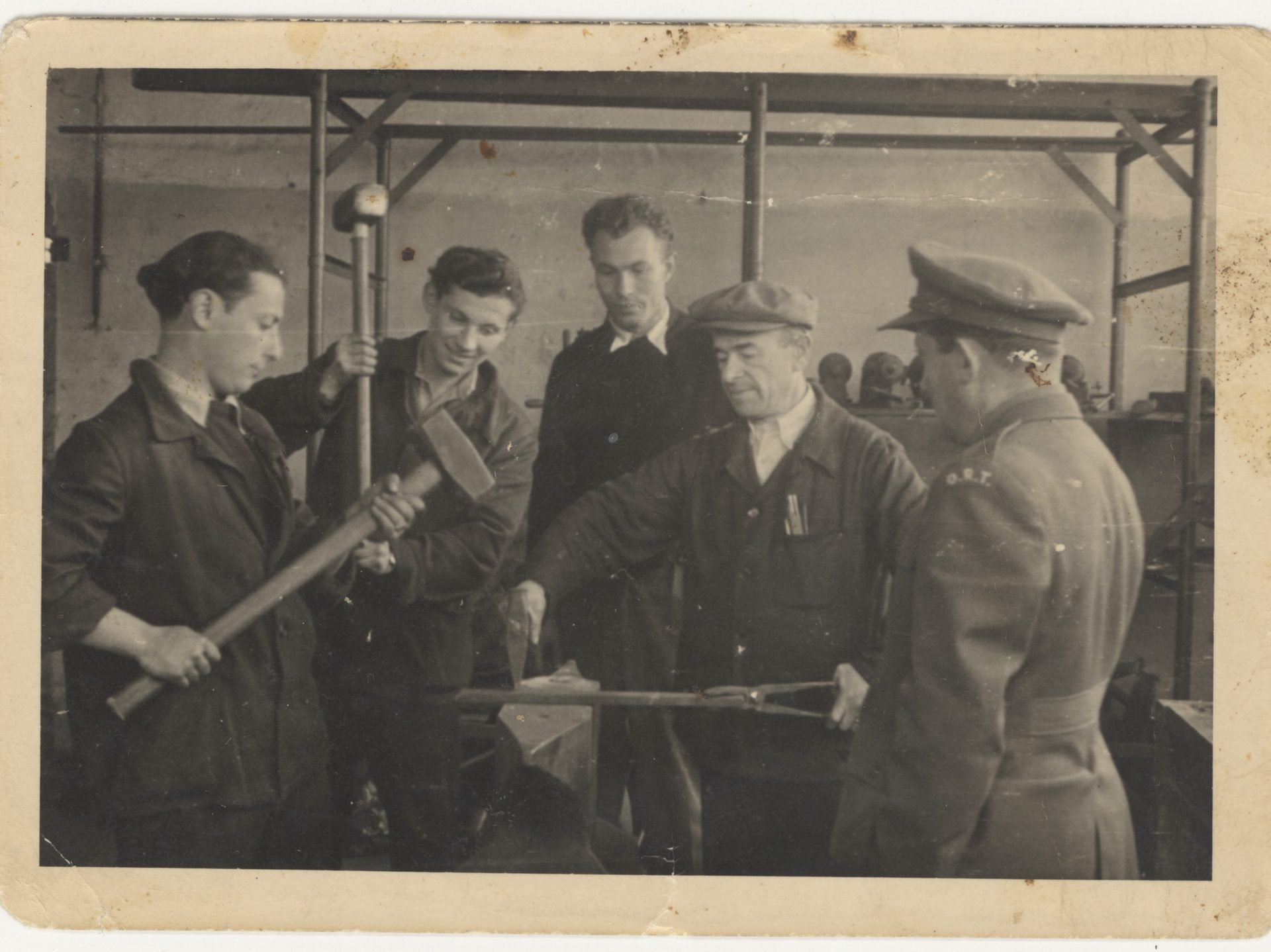 Photograph of men attending a mechanical engineering class at the Bergen-Belsen displaced persons camp in 1947.