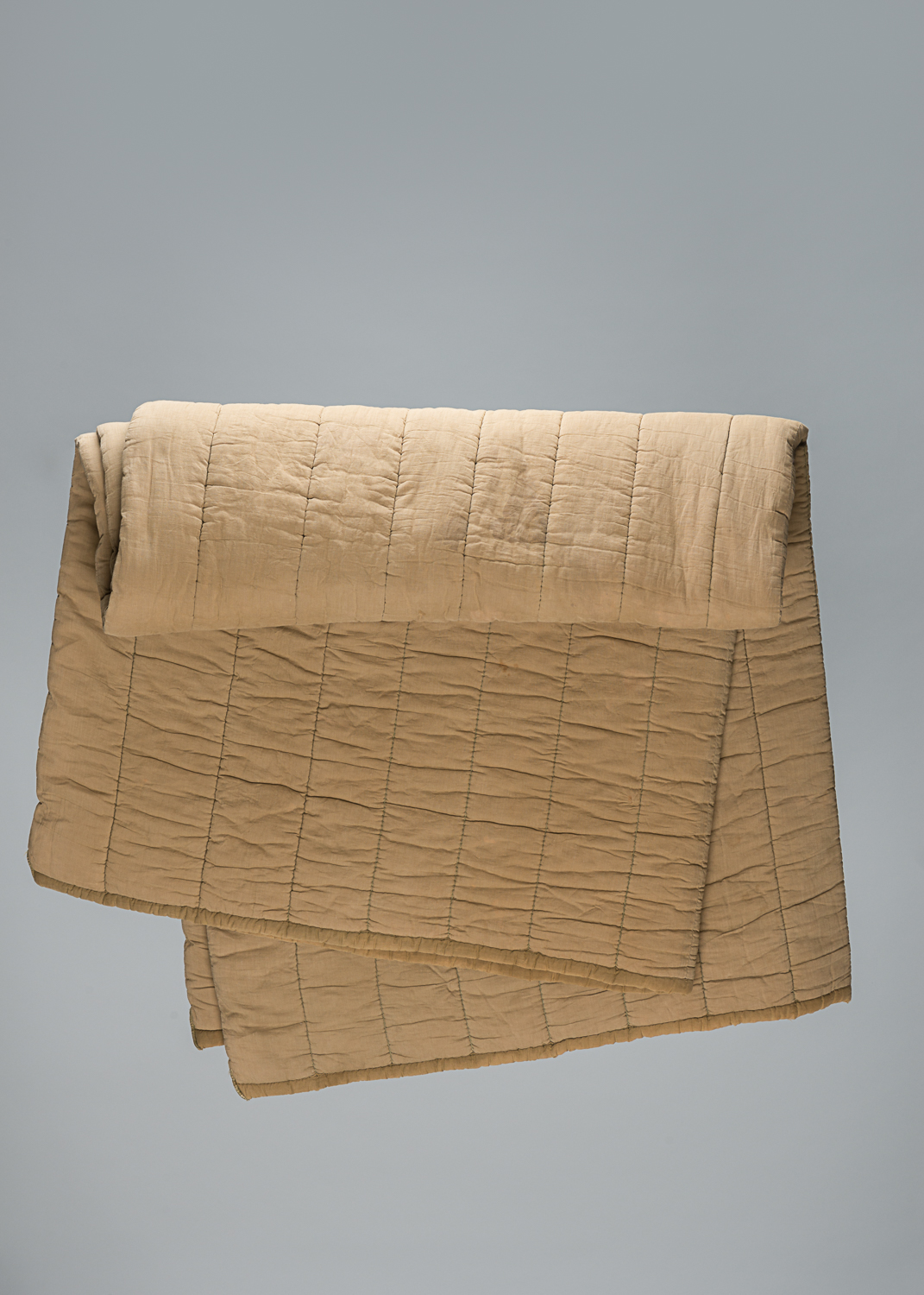 This large quilted blanket was given to Marcus (Max) Appelboom when he was a prisoner at the Auschwitz-Birkenau concentration camp.