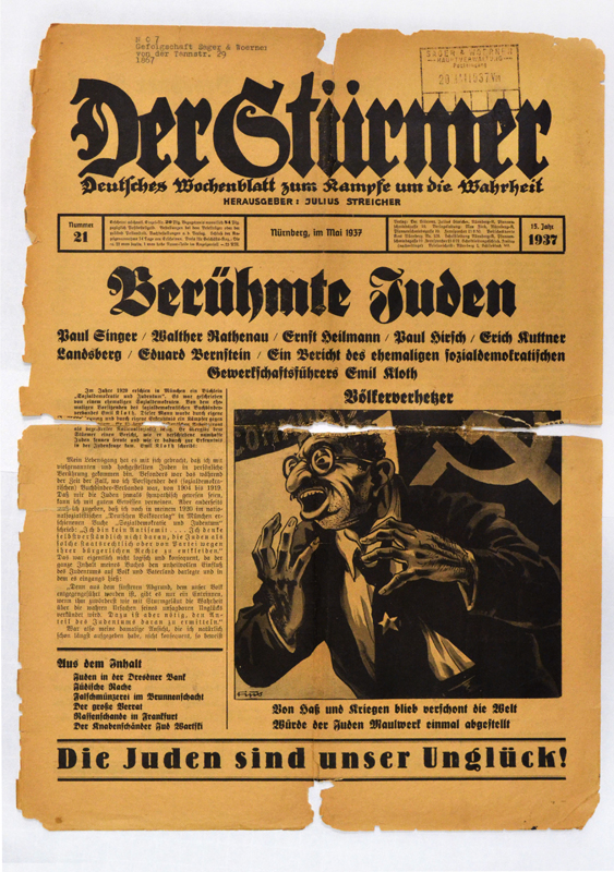 "Edition of Der Stürmer published in May 1935. At the bottom the front page of Der Stürmer's editions, the sentence ""Die Juden sind unser Unglück"" , meaning ""Jews are our misfortune"" was written."