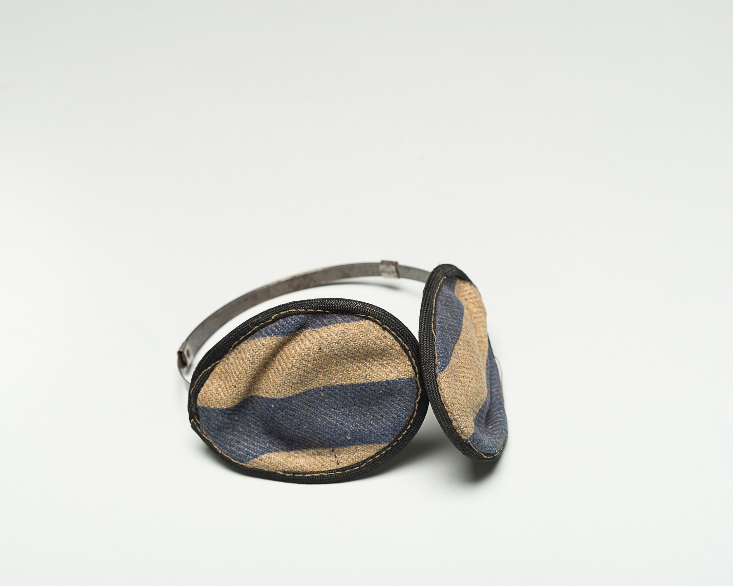 Earmuffs worn by Israel Viezel as protection from the elements when he was working in forced labour camps. (Photo: Peter Berra)