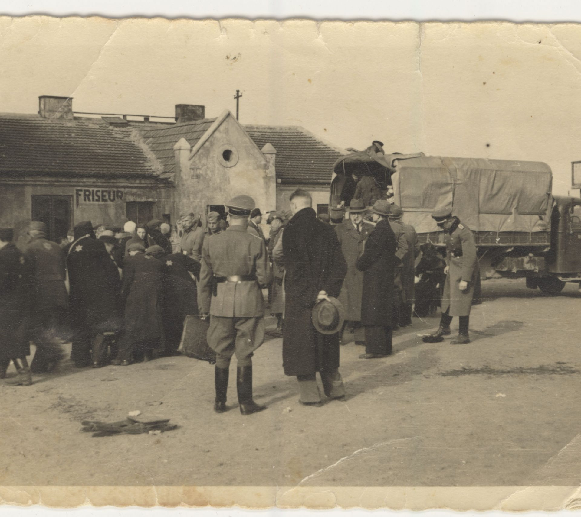 A group of Jewish residents of the Lublin ghetto stand in line to board a cattle car.