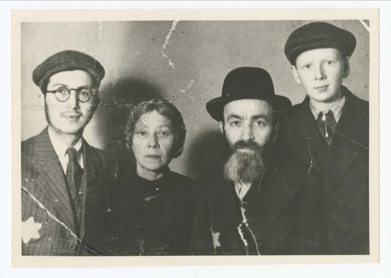 Eva Majerczyk's family shortly after the closure of the Lodz ghetto in 1940. From left to right: Yakov, Malka, Jechiel and Nachum. After the war, Eva discovered that her father and her older brother died in the Lodz ghetto. Her mother and younger brother were deported to Auschwitz and never returned.