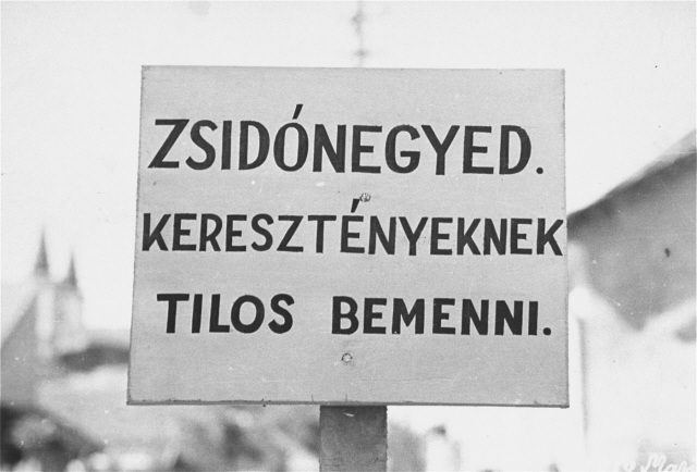 "A sign posted at the entrance to the Jewish quarter in Budapest. The Hungarian text reads, ""Entrance forbidden to Christians."" [Photograph #09050]"