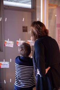 At the end of the exhibition, visitors are invited to write down their thoughts on a small postcard. © Montreal Holocaust Museum, Photography Stéphanie Cousineau-Bourassa