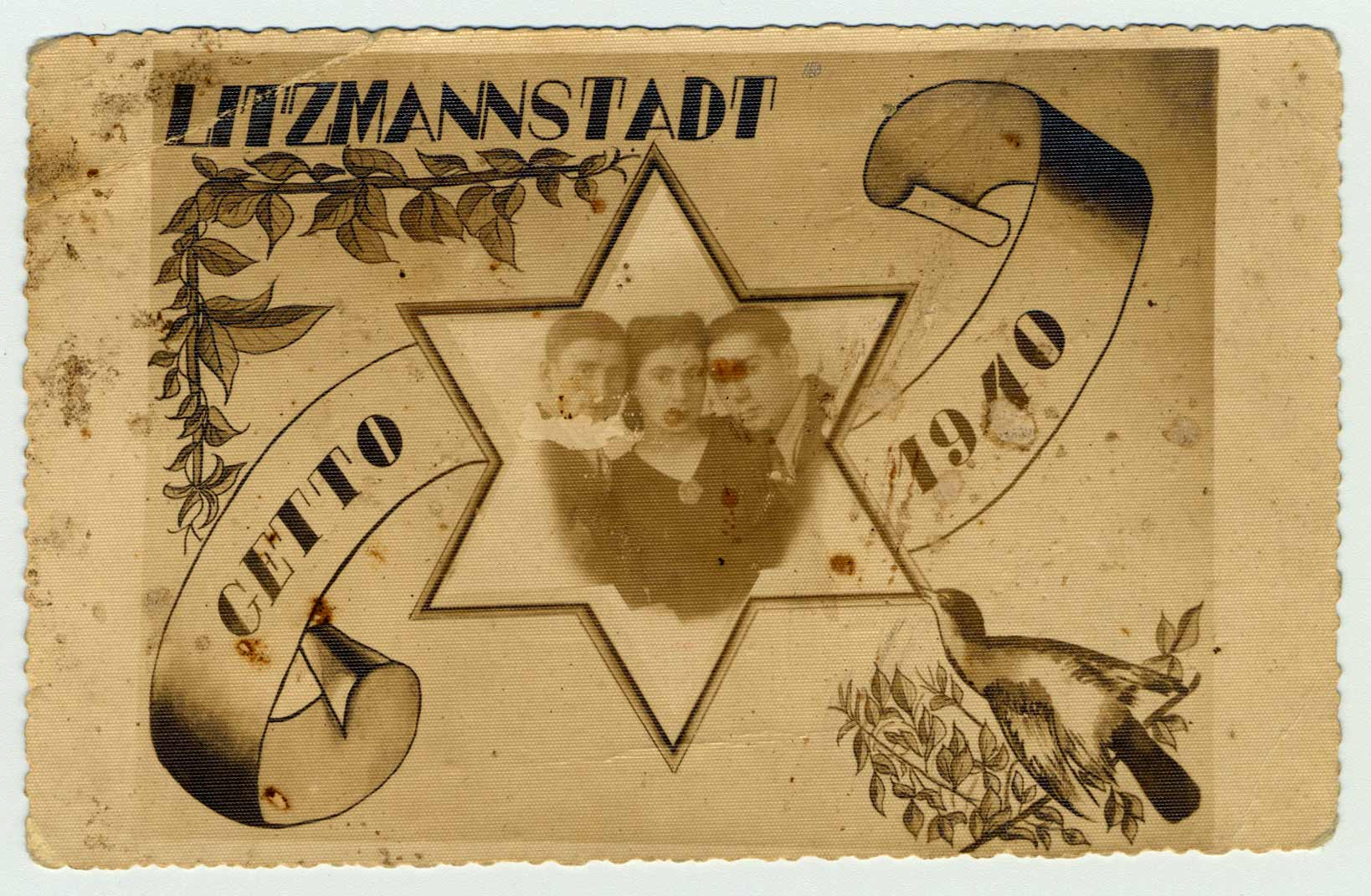 The postcard measures 4x6 inches. A vine and a dove are visible on an olive branch, both symbols of peace. Avrum Feigenbaum, his brother Mordechai, and his wife Minka took great risks to pose for this photo.